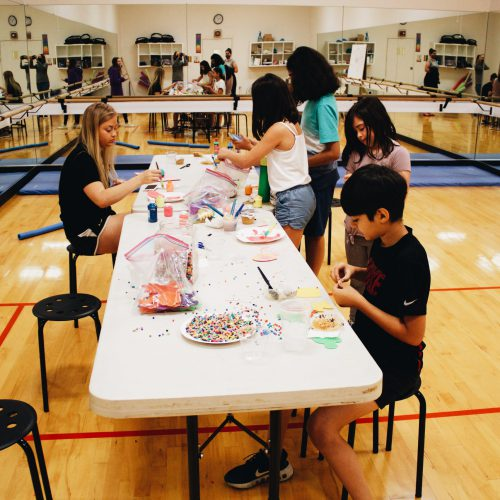 Bethany Athletic Club Summer Camp, kids doing crafts at a table in gym